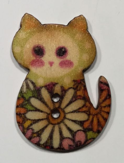 wooden button sitting cat